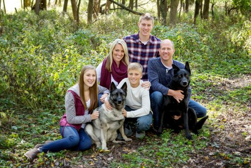family portraits in woods with two dogs