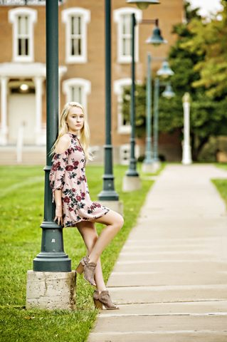 Senior Picture Information for senior sessions girl posing against light pole