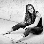 Black & White pictures girl sitting on sidewalk Bo Studio 121