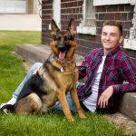 High school senior boy with German Shepard