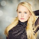 Senior Picture Gallery Girl with long blond hair and glittery top on glitter background