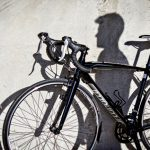 Creative senior picture bicycle shadow on wall Bo Studio 121