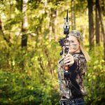 High School senior girl with bow and arrow