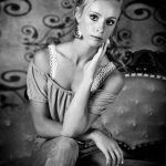 black and white senior portrait girl sitting on victorian couch