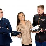 fun image of older siblings in military uniforms