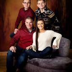 Family portrait on studio background photographed in Waverly